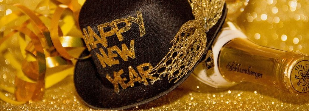 Happy New Year Hat and Champagne Bottle on Gold Background