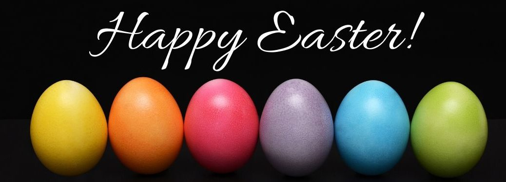 Colored Eggs on a Black Background with White Happy Easter Text
