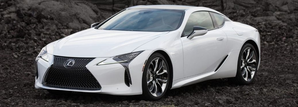 White 2021 Lexus LC Coupe Front Exterior on Dark Rock Background