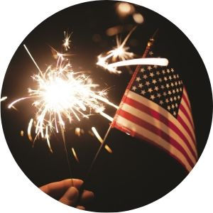 Close Up of a Sparkler and American Flag
