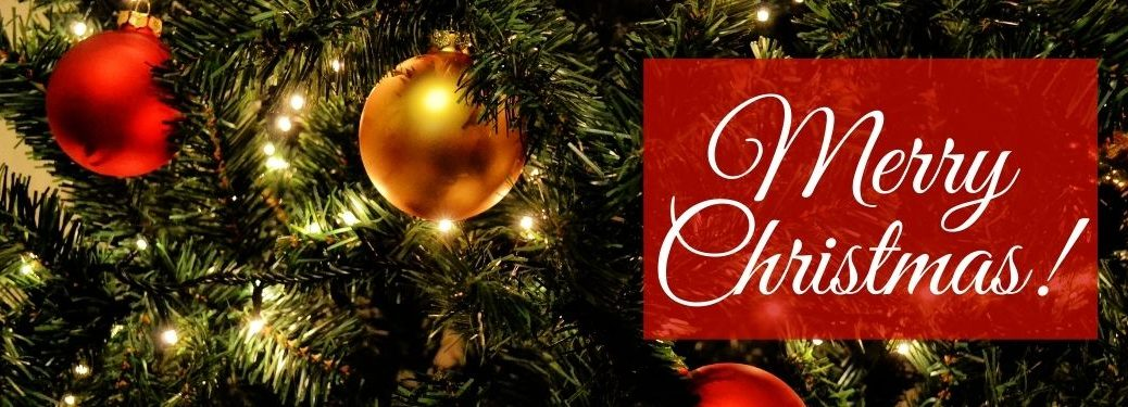 Red and Gold Ornaments on a Christmas Tree with White Merry Christmas! Text on a Red Background
