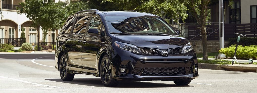 front view of black toyota sienna driving