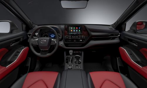 2021 Toyota Highlander XSE interior shot of front seating Softex, steering wheel, and dashboard design