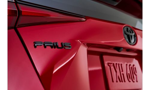 2021 Toyota Prius 20th Anniversary 2020 Edition exterior shot closeup in Supersonic Red color or model name badge