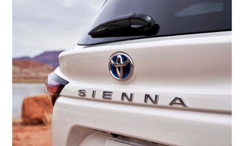 2021 Toyota Sienna exterior rear closeup shot of Sienna nameplate badge on white paint color
