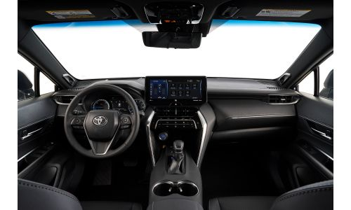 2021 Toyota Venza interior shot of front seating, steering wheel, and dashboard layout