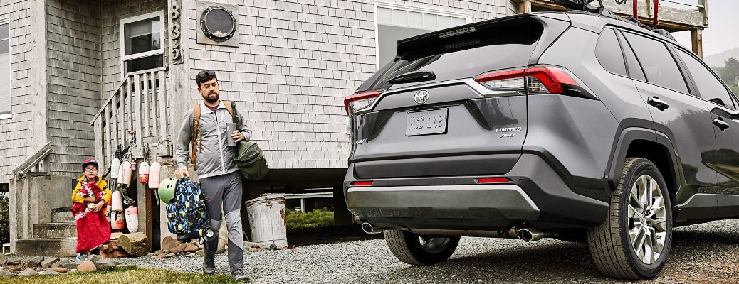 2021 Toyota RAV4 gray back view man approaching with gear