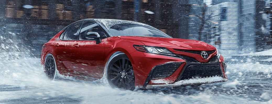 2021 Toyota Camry red side view in snow