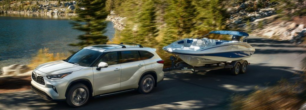 2021 Toyota Highlander towing a boat