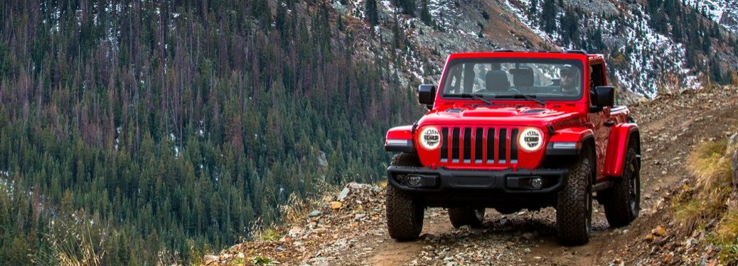 2020 Jeep Wrangler red front view on a mountain