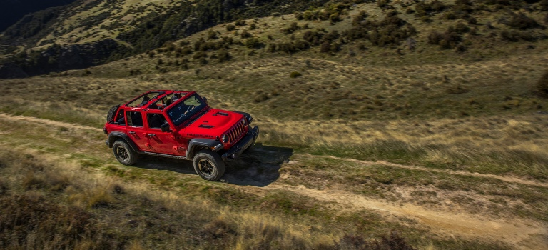 2020 Jeep Wrangler red side view tire and wheel closeup