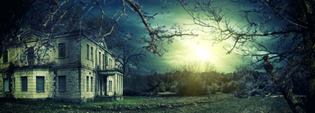 Haunted house with sunshine peaking through clouds