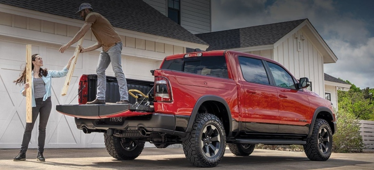 2020 RAM 1500 red being loaded with cargo back view