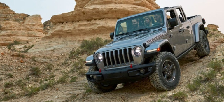 2020 Jeep Gladiator Rubicon gray going down hill front view