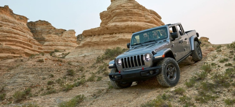 2020 Jeep Gladiator silver front view going downhill