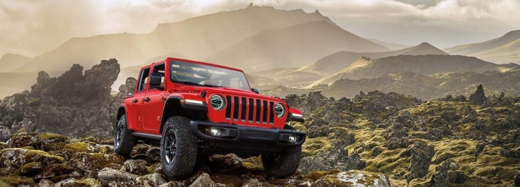 2020 Jeep Wrangler red front view climbing rocks