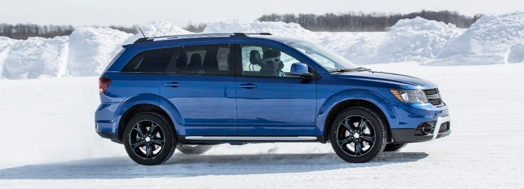 2020 Dodge Journey blue side view in snow