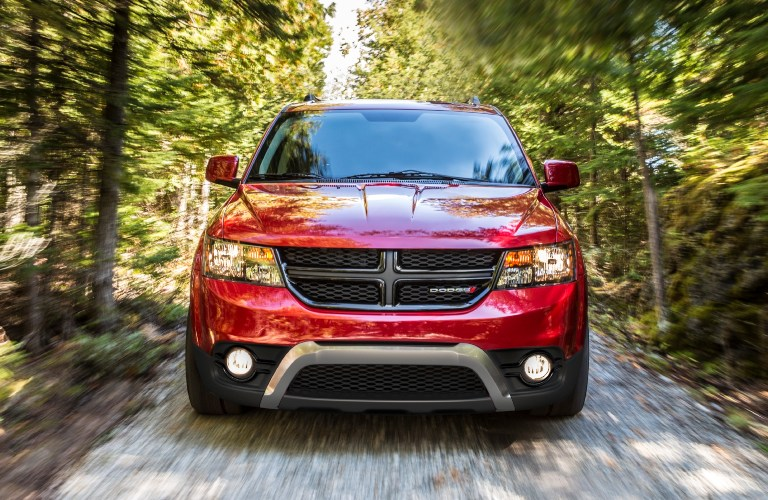 2020 Dodge Journey red front view in trees