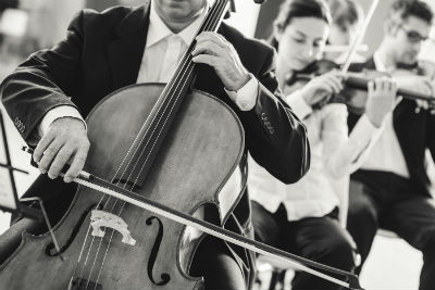 cello player in suit playing