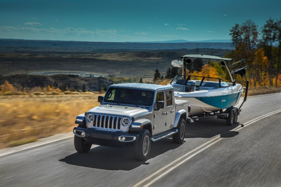 A photo of the 2020 Jeep Gladiator pulling a boat.