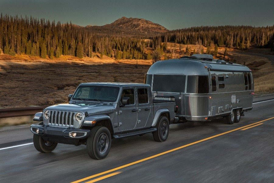 A photo of the 2020 Jeep Gladiator pulling an Airstream trailer.