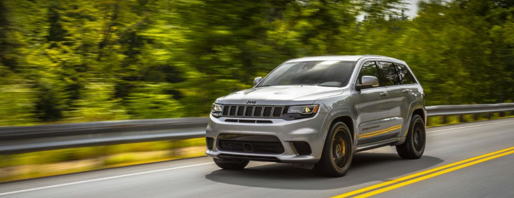 A front left quarter photo of the 2020 Jeep Grand Cherokee on the road.