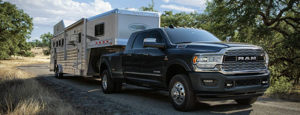 A photo of the 2020 Ram 3500 pulling a trailer.