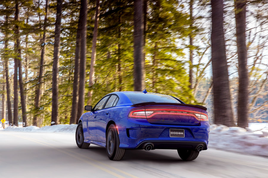 A rear photo of the 2020 Dodge Charger GT AWD going around a corner.