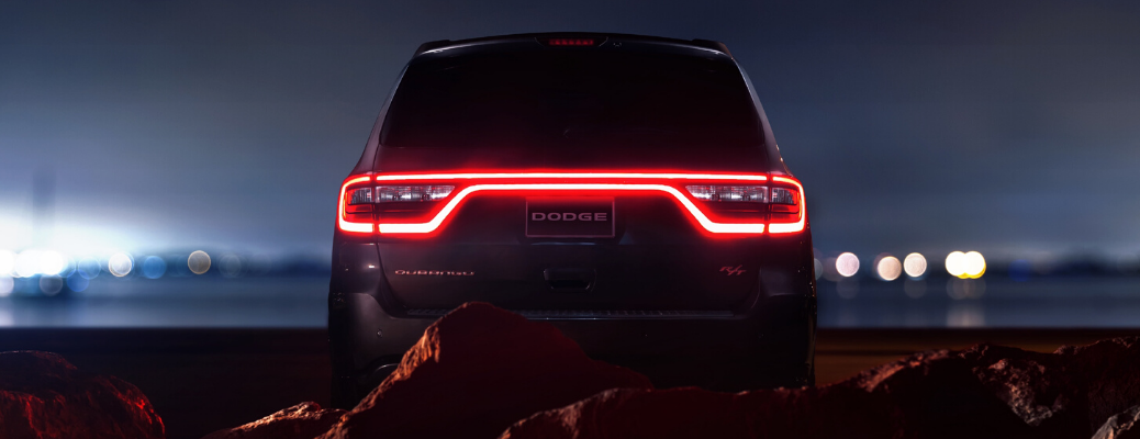 Rear view of 2020 Dodge Durango RT in the dark with lights on
