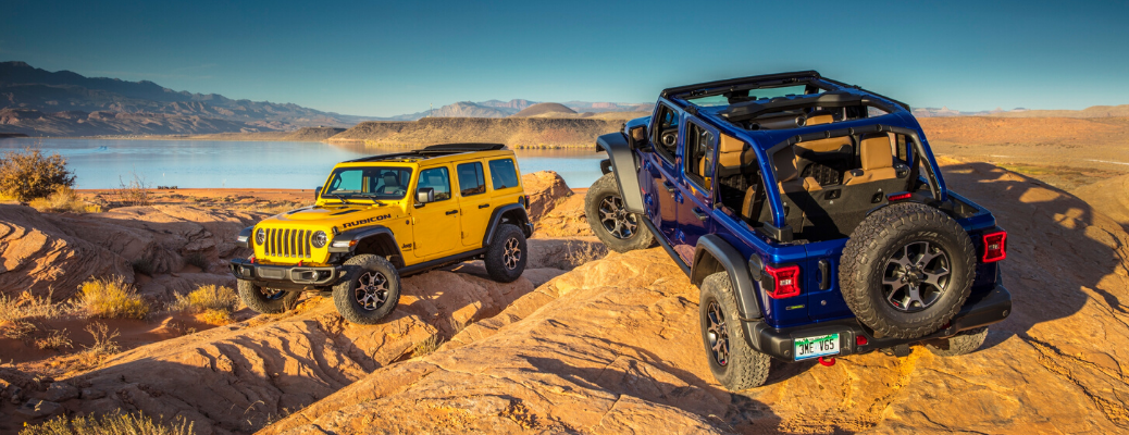 Yellow and Blue 2020 Jeep Wrangler rock crawling
