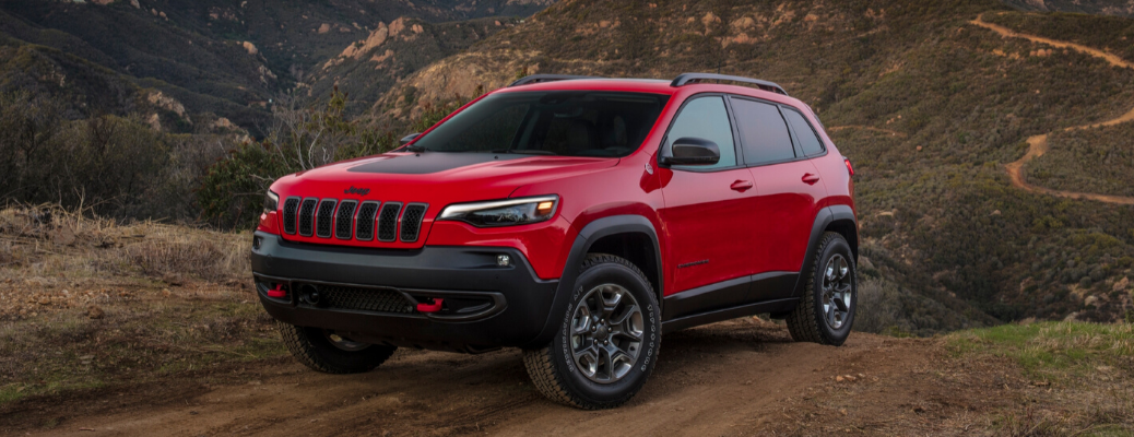 Red 2020 Jeep Cherokee Trailhawk on off-road path