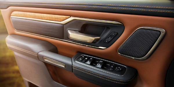 Wood, leather, and metal door accents of 2020 Ram 1500 Laramie Longhorn