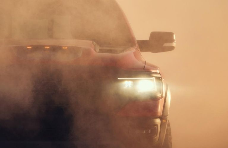 Close Up of 2021 Ram 1500 TRX Front Headlights in Dust Cloud
