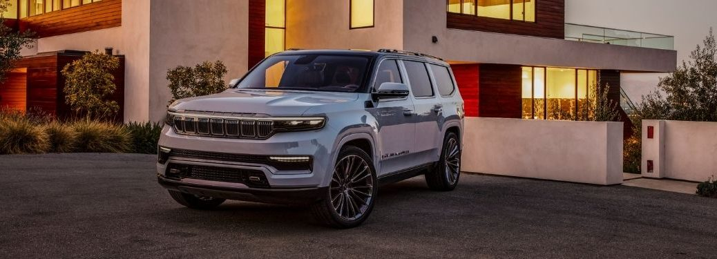 White 2021 Jeep Grand Wagoneer Concept in a Driveway at Dusk