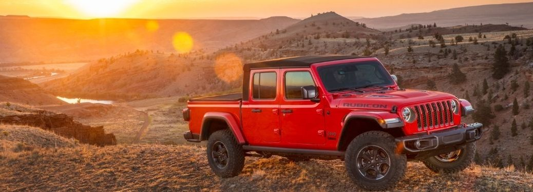 Red 2021 Jeep Gladiator on a Mountain at Sunset