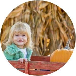 Girl in a Wagon with a Pumpkin