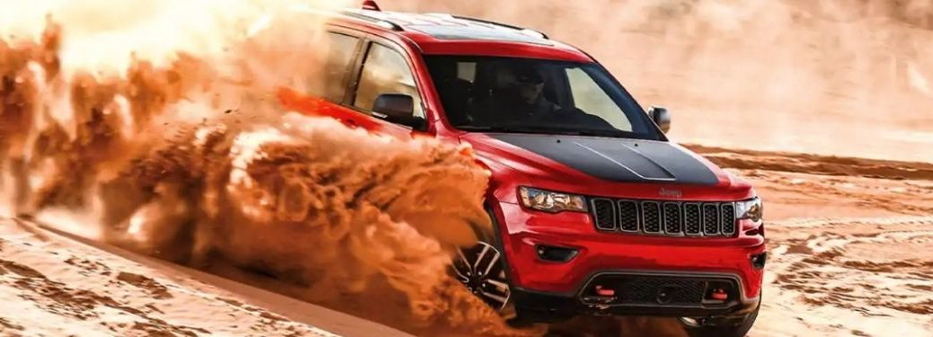 Red 2021 Jeep Grand Cherokee Driving in Sand Dunes