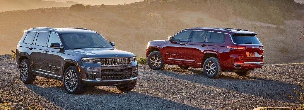 Gray and Red 2021 Jeep Grand Cherokee L Models in a Field