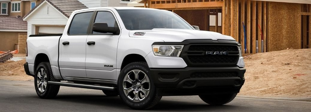 White 2021 Ram 1500 HFE EcoDiesel Front Exterior at a Construction Site