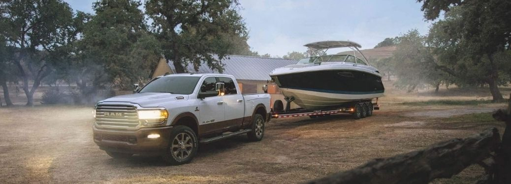 White 2021 Ram 2500 Towing a Boat