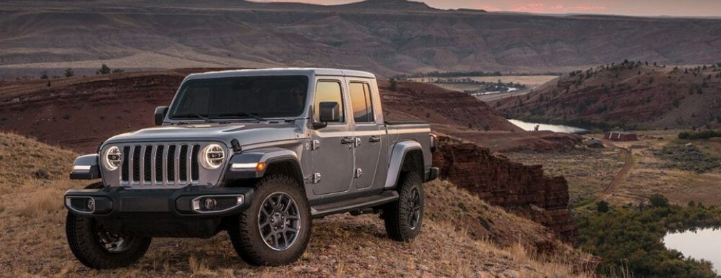 2020 Jeep Gladiator driving on a hill and parked outside