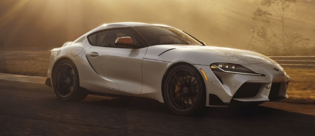 2019 toyota supra driving through the country side