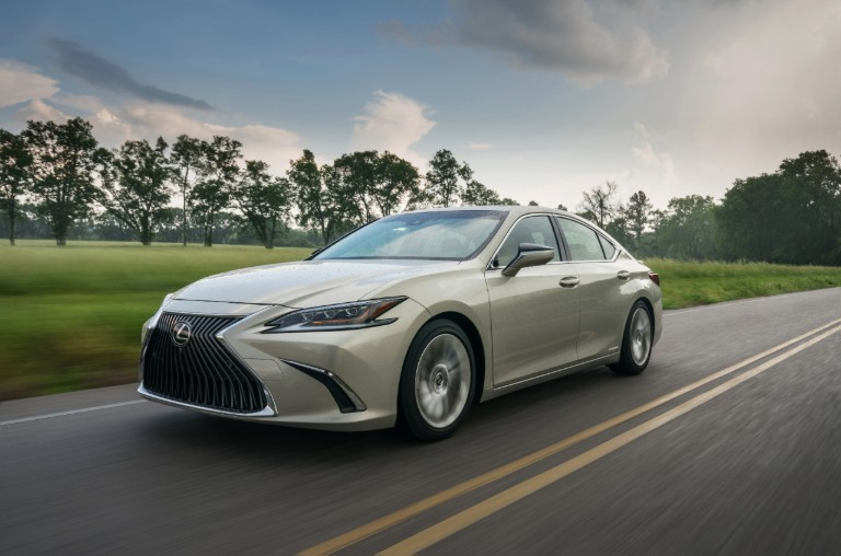 2019 Lexus ES 300h driving fast on a sunny day