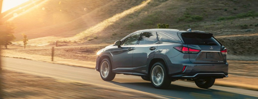 2020 Lexus RX driving at sunset
