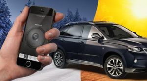 A hand holding a smartphone with the 2020 Lexus RX in the background