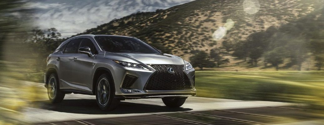 2020 Lexus RX F Sport driving on a sunny day
