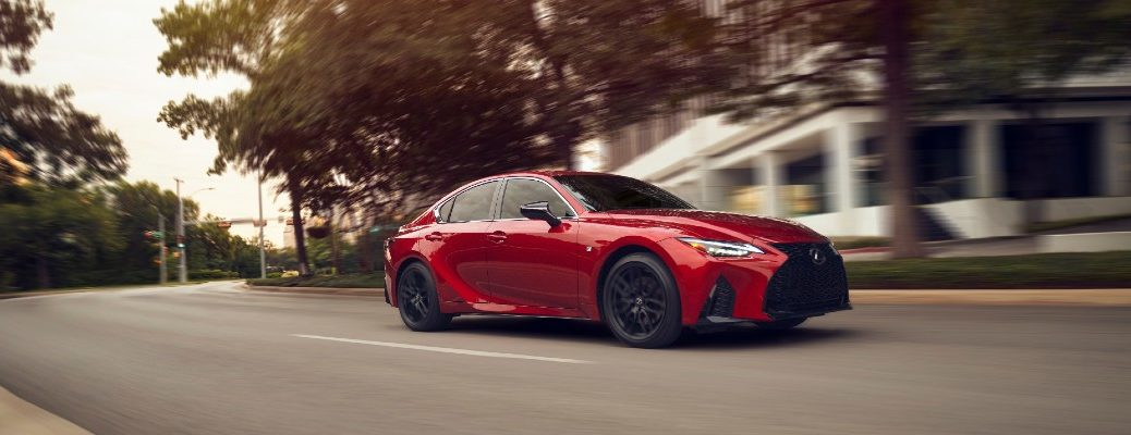 A front right profile photo of the 2021 Lexus IS on the road.