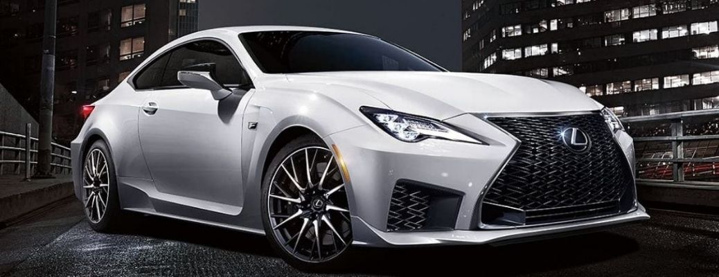 The 2021 Lexus RC-F in white parked on a bridge at night