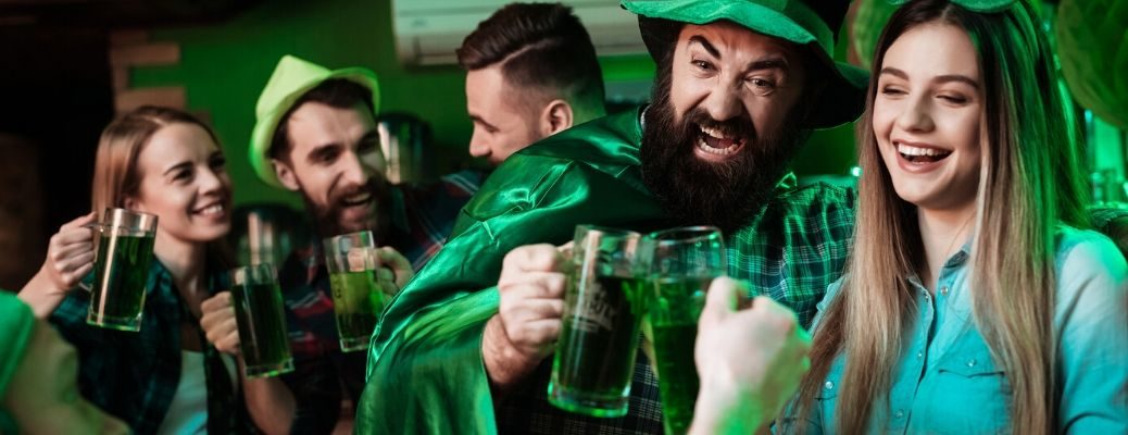 people dressed in green celebrating St. Patrick's Day