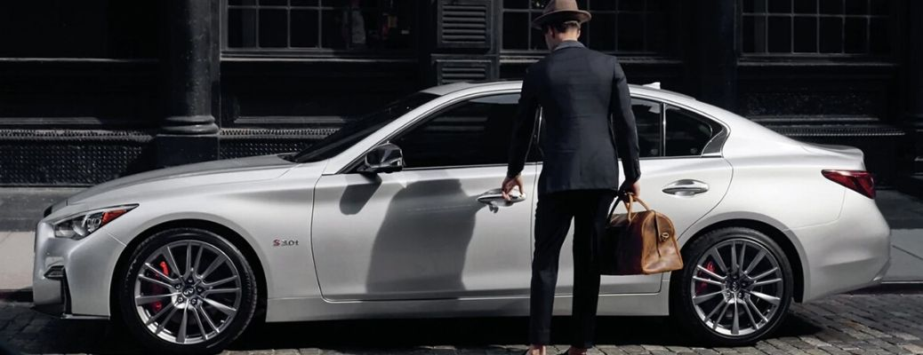 2020 INFINITI Q50 parked with a man walking to it